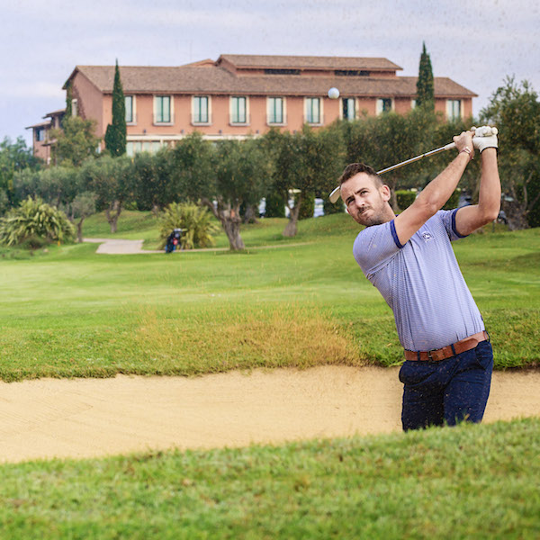 Male golfer in bunker at Peralada Golf, Costa Brava