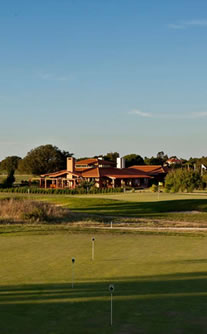 Clubhouse and practice putting green at Santa Estevao Golf